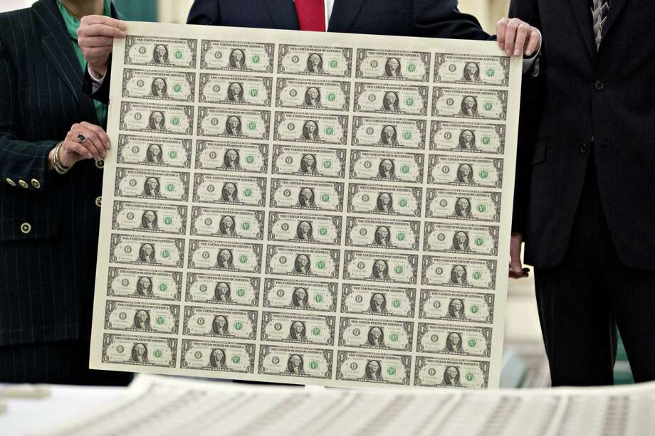 An uncut sheet of $1 dollar notes at the U.S. Bureau of Engraving and Printing in Washington on Wednesday, Nov. 15, 2017. MUST CREDIT: Bloomberg photo by Andrew Harrer. Photo: Andrew Harrer, Bloomberg / Bloomberg / © 2017 Bloomberg Finance LP