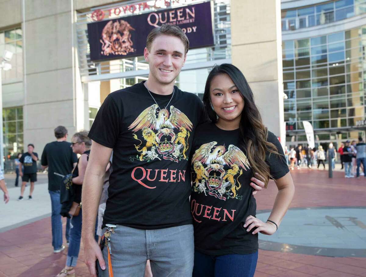 Fans pose for a photograph before the Queen + Adam Lambert: The Rhapsody Tour at Toyota Center on Wednesday, July 24, 2019, in Houston.