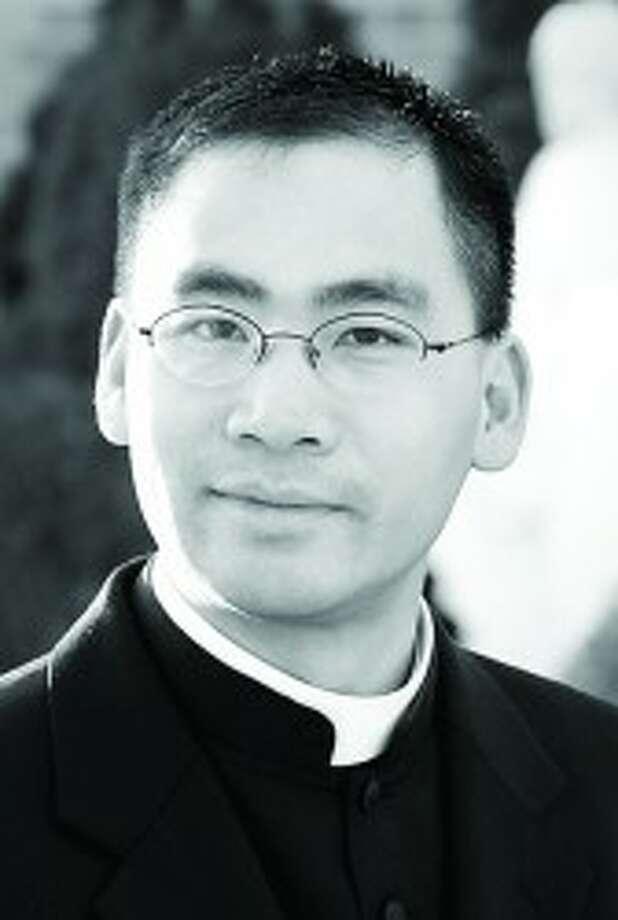 Father Lam T. Le