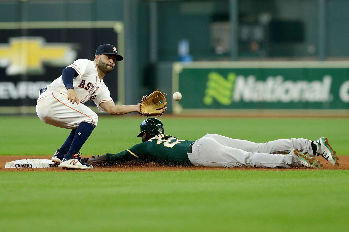 HOUSTON, TX - JULY 24: Jurickson Profar #23 of the Oakland Athletics steals second as Jose Altuve #27 of the Houston Astros fields the throw in the fifth inning at Minute Maid Park on July 24, 2019 in Houston, Texas. (Photo by Tim Warner/Getty Images)