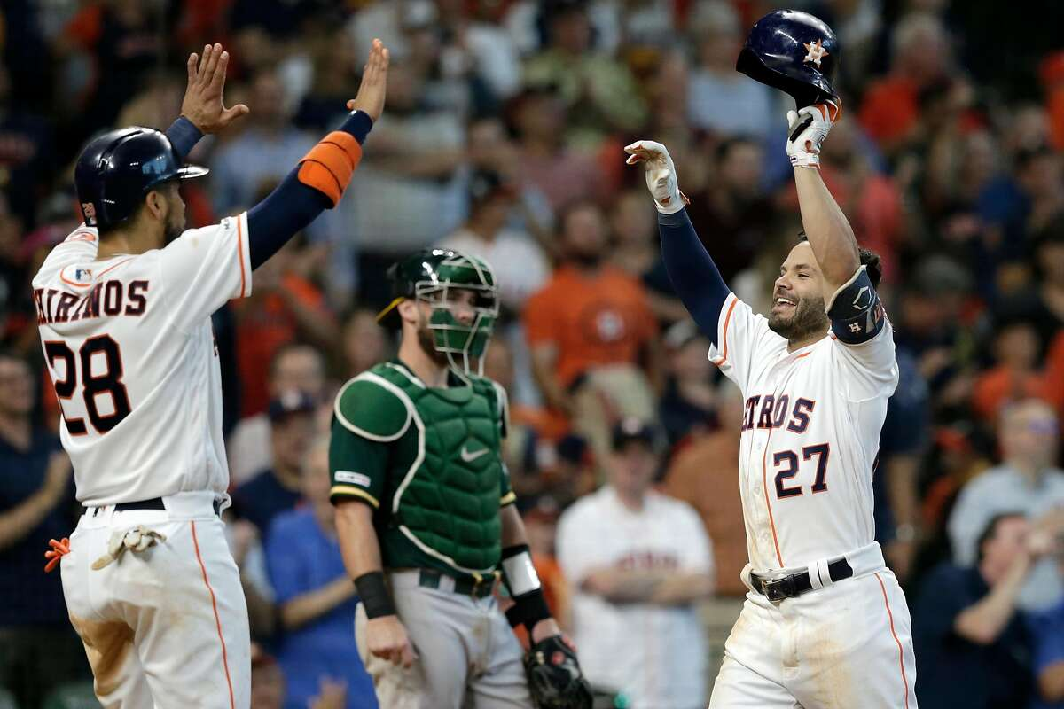 HOUSTON, TX - JULY 24: Robinson Chirinos #28 of the Houston Astros congratulates Jose Altuve #27 after a two run home run in the fifth inning against the Oakland Athletics at Minute Maid Park on July 24, 2019 in Houston, Texas. (Photo by Tim Warner/Getty Images)