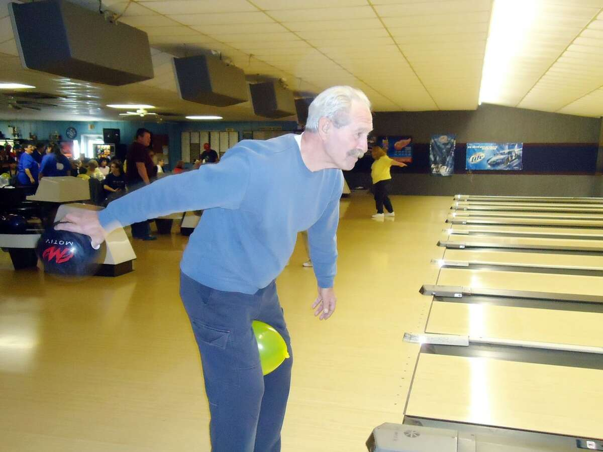 WHACKY BOWLER: A Bowl-A-Thon fundraiser participant gets ready to throw his ball down the lane last month. The fundraiser benefited the Mecosta County Commission on Aging and Senior Center's transportation program and is expected to have raised more than $9,000. (Courtesy photo)