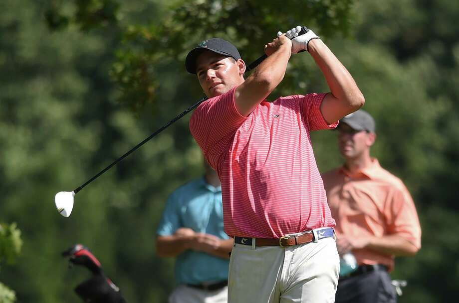 New Canaan's CJ Swift follows through on a drive during the 2017 Connecticut Open golf championships at Woodway Country Club in Darien. Photo: Dave Stewart / Hearst Connecticut Media / Hearst Connecticut Media