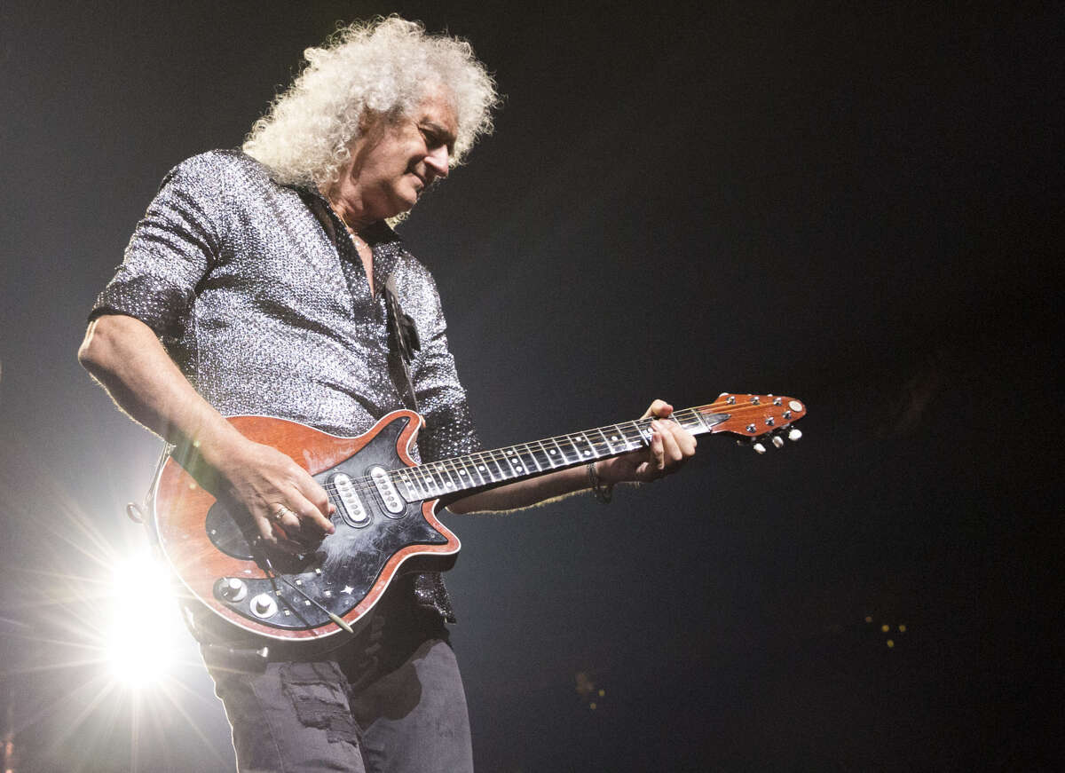 Brian May performs as part of Queen + Adam Lambert at Houston's Toyota Center on July 25, 2019.