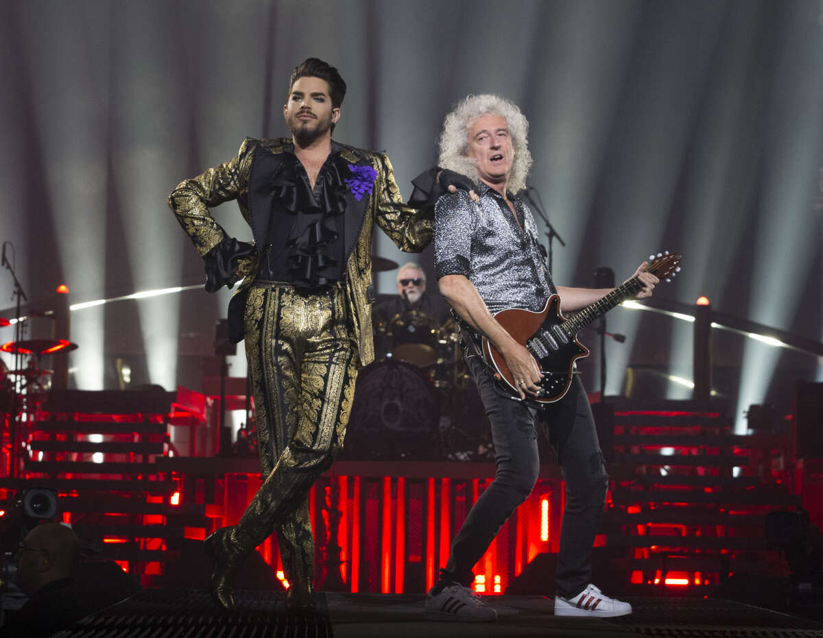 Adam Lambert and Brian May performs as part of Queen + Adam Lambert at Houston's Toyota Center on July 25, 2019.