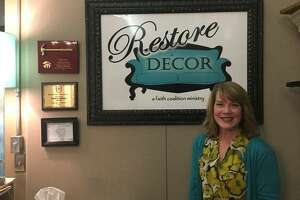 Restore Décor founder and Executive Director Dana Adams stands at the desk of Restore Décor's retail store, at 111 N. Second St., in Edwardsville. Adams founded the 100% volunteer-operated nonprofit outreach organization in 2013. She lives in Edwardsville with her husband and daughter, Emilee, 18, who will attend the University of Southern Indiana this fall, majoring in biology and pre-dentistry; their son, Justin, 24, is an engineer in Dallas, Texas.