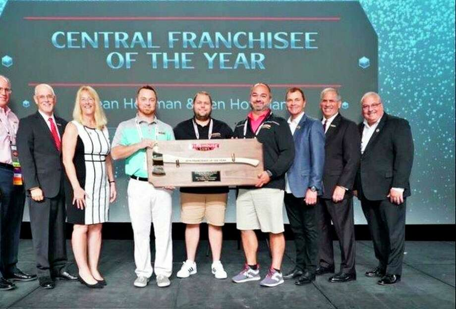Firehouse Subs franchisees Ken Hoffman and Sean Hoffman recently were named Franchisees of the Year for Firehouse Subs for the Central Region. Hoffman reports this is a very prestigious award to receive from Firehouse Subs, and they couldn't have done it without all of their hard working employees and loyal customers. This is a Facebook photo from the Firehouse Subs Business Conference in Orlando, Florida. (Provided Photo)