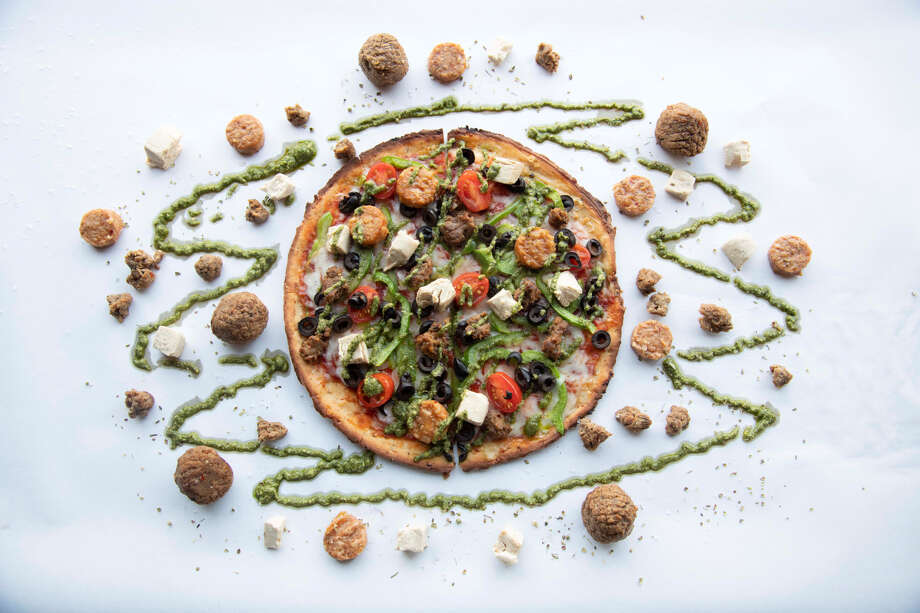 "Pieology Pizzeria - StamfordPlant-based protein options: ""Spicy Italian Sausage Rounds,"" ""Beef Meatball,"" ""Diced Chicken"" toppings are vegan, non-GMO verified, contain no cholesterol or soluble fats.