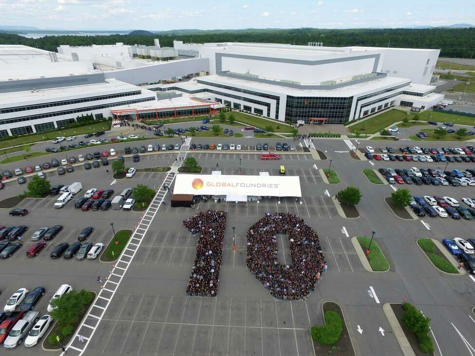 Employees at GlobalFoundries in Malta take a photo in the shape of a 10 to celebrate the 10th anniversary of Fab 8