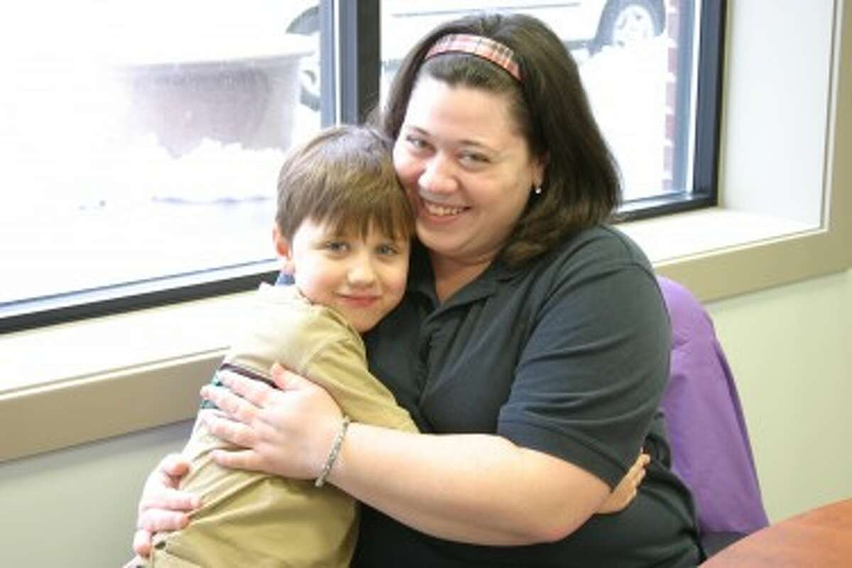 LOTS TO TALK ABOUT: Ethan Lance, 7, of Remus, and his mother, Kendra, took some time to stop by the Pioneer to discuss a wide range of topics. (Pioneer photo/Lauren Fitch)
