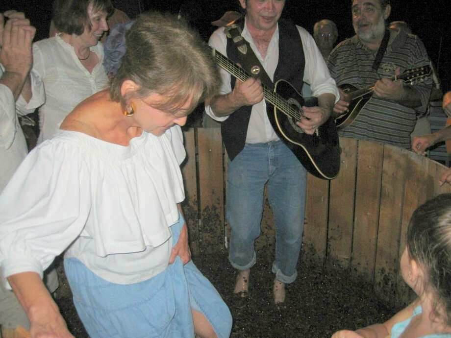 Join the Bernhardts at their Winery on Aug. 4 to celebrate their anniversary and stomp grapes. The renowned singer, Shake Russell, got into the grape stomp pit with Jerri Bernhardt to get purple feet while stomping grapes. Be careful in that grape stomp pit since it is slippery! Photo: Courtesy Photo
