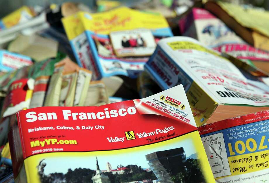 A pile of phone books, which presumably no one wants, in San Francisco. New Fairfield County directories will be delivered at the end of this year, but residents may opt out of receiving them. Photo: Justin Sullivan / Getty Images / Getty Images North America