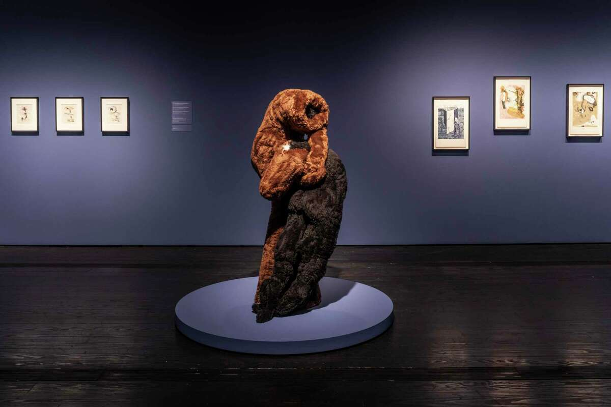 """An view of """"Collection Close-Up: The Graphic Work of Dorothea Tanning,"""" which is grounded by the 1970 soft sculpture """"Cousins."""" The show is up through Oct. 13 at the Menil Collection."""