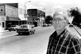 Coleman's Robert M. Simons stands along the city streets. Simons' ancestors came to Coleman more than 116 years ago. May 1987