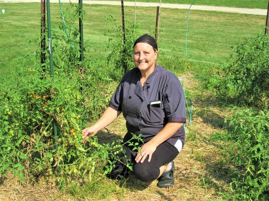 Kelsi Baker Walden, executive chef at Bakers & Hale in Godfrey, grows ingredients for her meals in her own garden. The year-old restaurant is launching a take-out menu on Saturday and also is planning an Aug. 3 hog roast.
