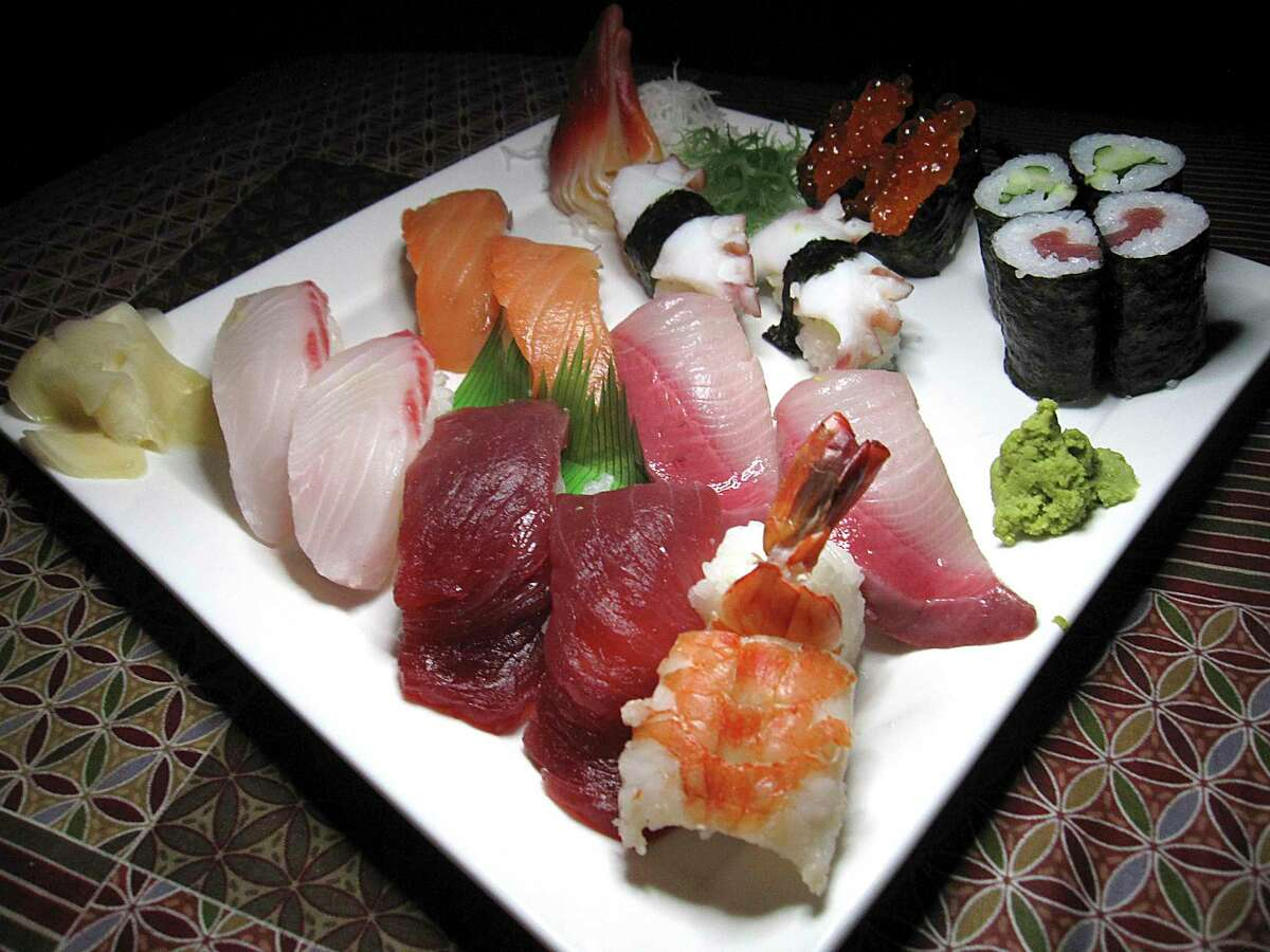 A sushi sampler includes shrimp, tuna, whitefish, yellowtail, smoked salmon, octopus, salmon roe, clam, tuna rolls and cucumber rolls at Niki's Tokyo Inn.