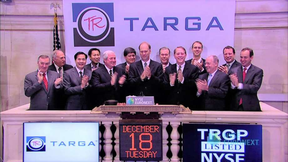 Targa Resources CEO Joe Bob Perkins and other company executive ringing the bell at bell at the New York Stock Exchange during a December 18, 2012 visit. Photo: Targa Resources