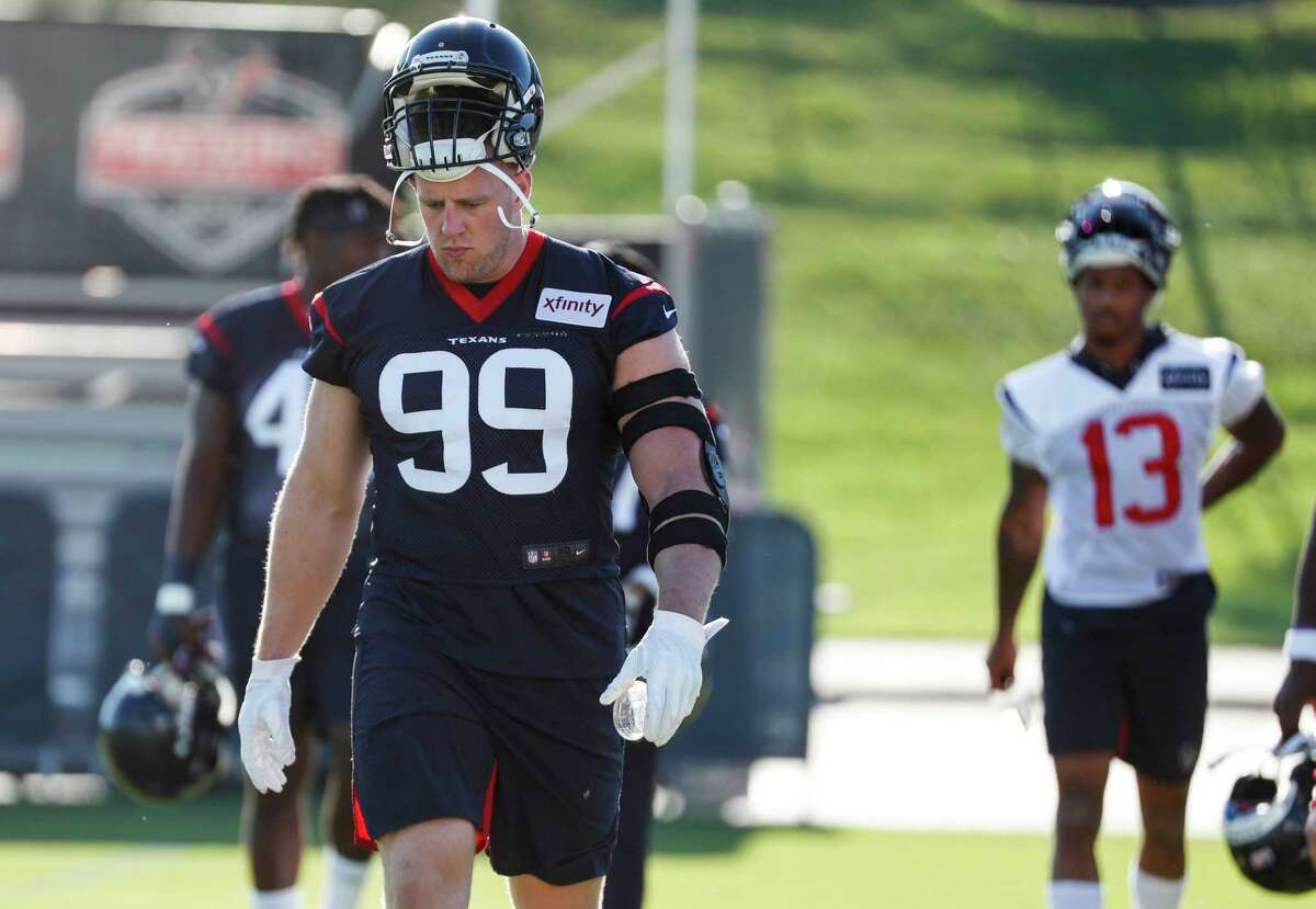 Houston Texans defensive end J.J. Watt (99) walks onto the practice field for the first day of training camp at the Methodist Training Center on Thursday, July 25, 2019, in Houston.