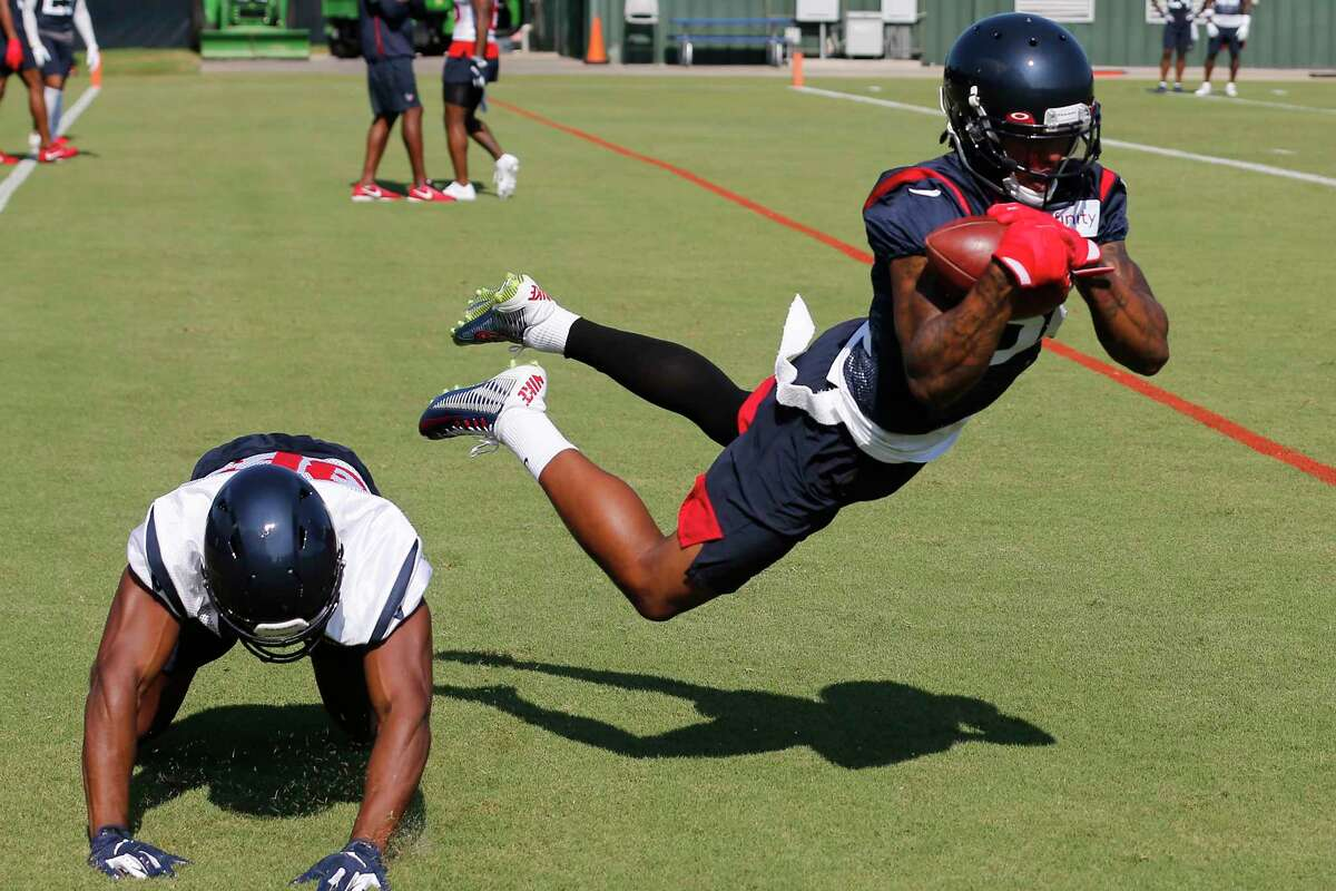 Houston Texans cornerback Lonnie Johnson (32) intercepts a pass intended for Houston Texans wide receiver Jester Weah (86) during training camp at the Methodist Training Center on Thursday, July 25, 2019, in Houston.