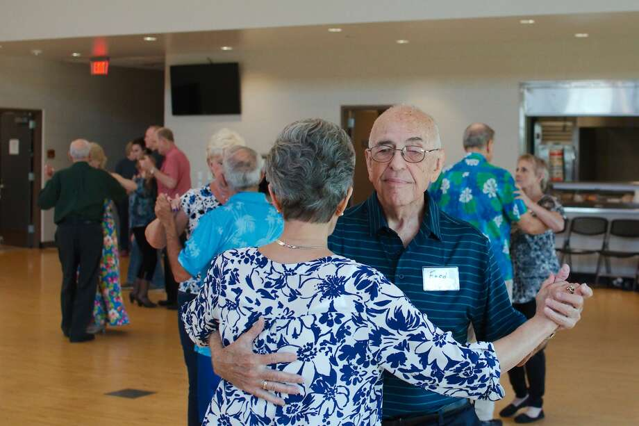 Fred White and Becky Clayton enjoy ballroom dancing every Wednesday at Hometown Heroes Park. Photo: Kirk Sides/Staff Photographer