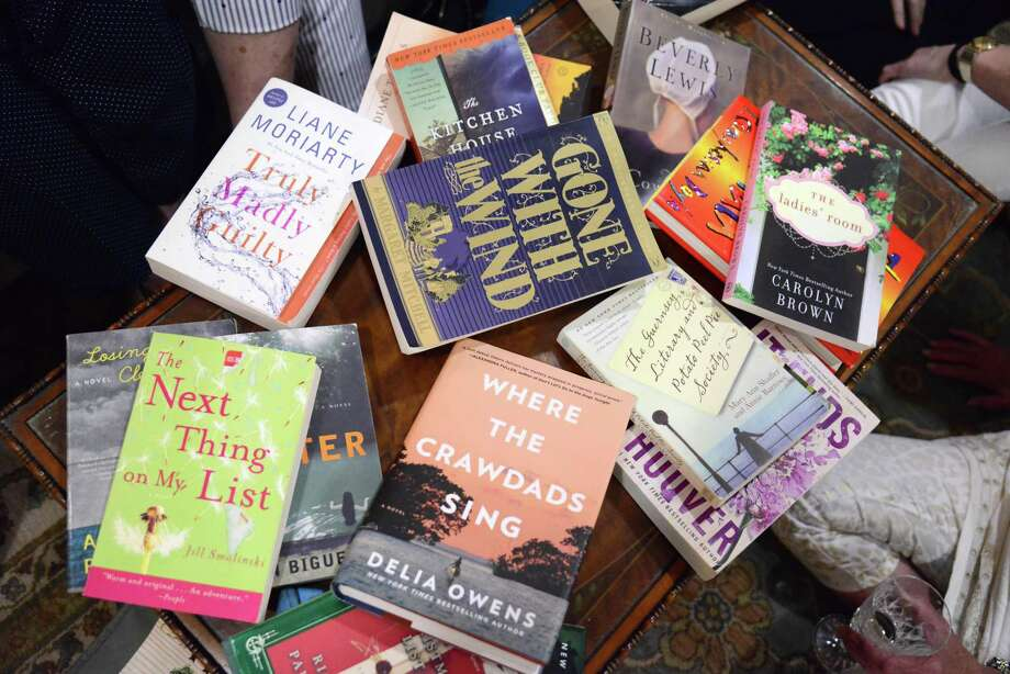 "For the past eight years, the dozen members of the Rookie Bookies book club have met the first Monday of each month at a member's home. Club members describe their book discussions as ""lively."" Photo: John Fulbright"