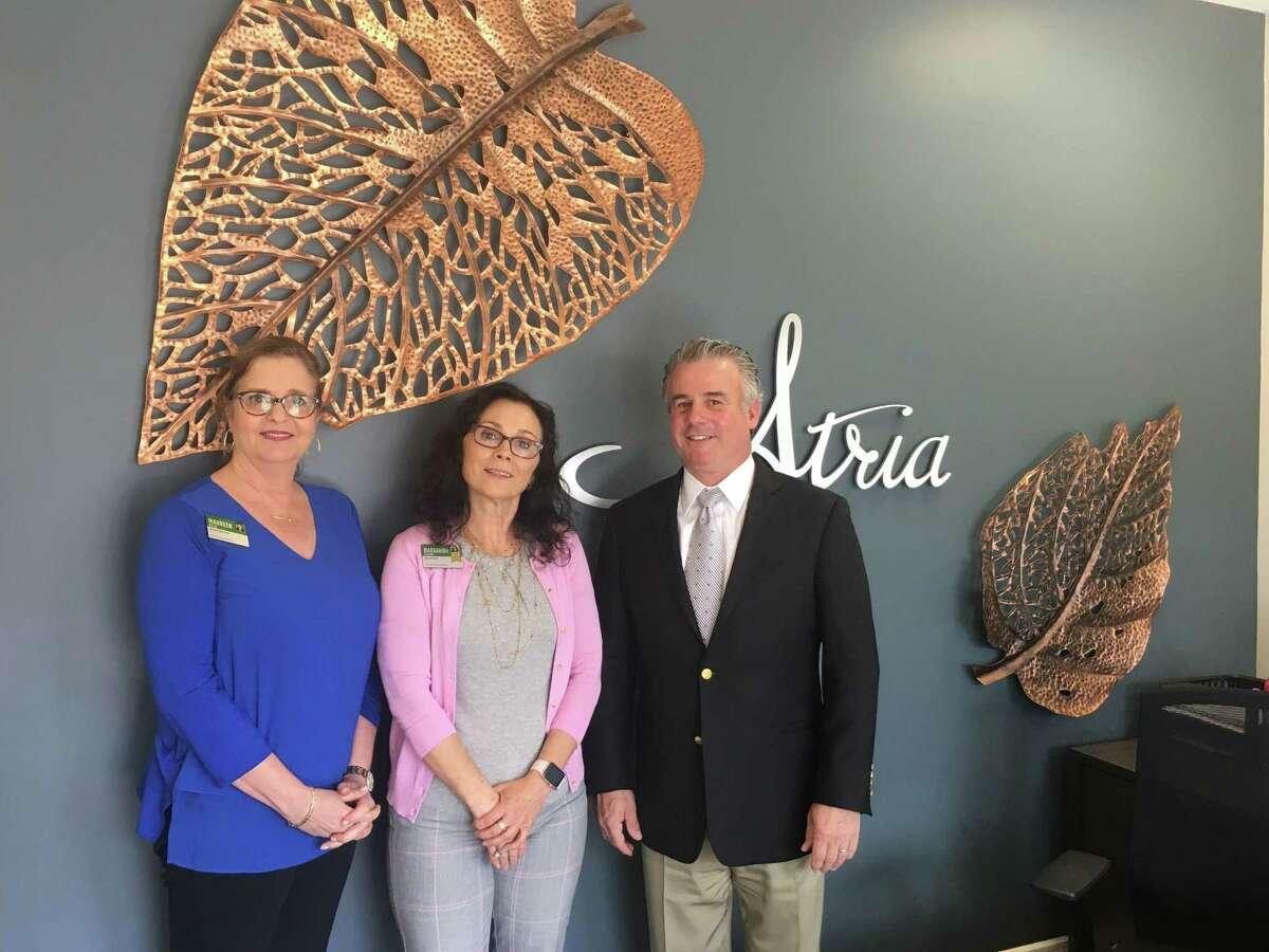 Maureen McLam, Margarida Velardo and John Hartmayer inside Atria Ridgefield's pop-up shop on Main Street. Atria Ridgefield will open on Old Quarry Road this fall.