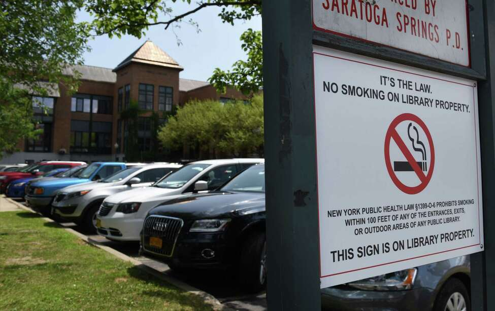 No smoking signs are placed around the parking lot at Saratoga Springs Public Library on Thursday, July 25, 2019, in Saratoga Springs, N.Y. A new smoking restriction could play havoc on the library, which is smack dab in the middle of multiple bars. (Will Waldron/Times Union)