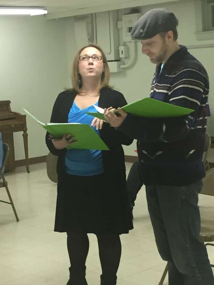 """REHEARSALS: Beth Miller, who plays the Science Officer, and Andy Kirby, who portrays """"Cookie,"""" rehearse a scene from STAGE-M's upcoming production of """"Return to the Forbidden Planet."""""""