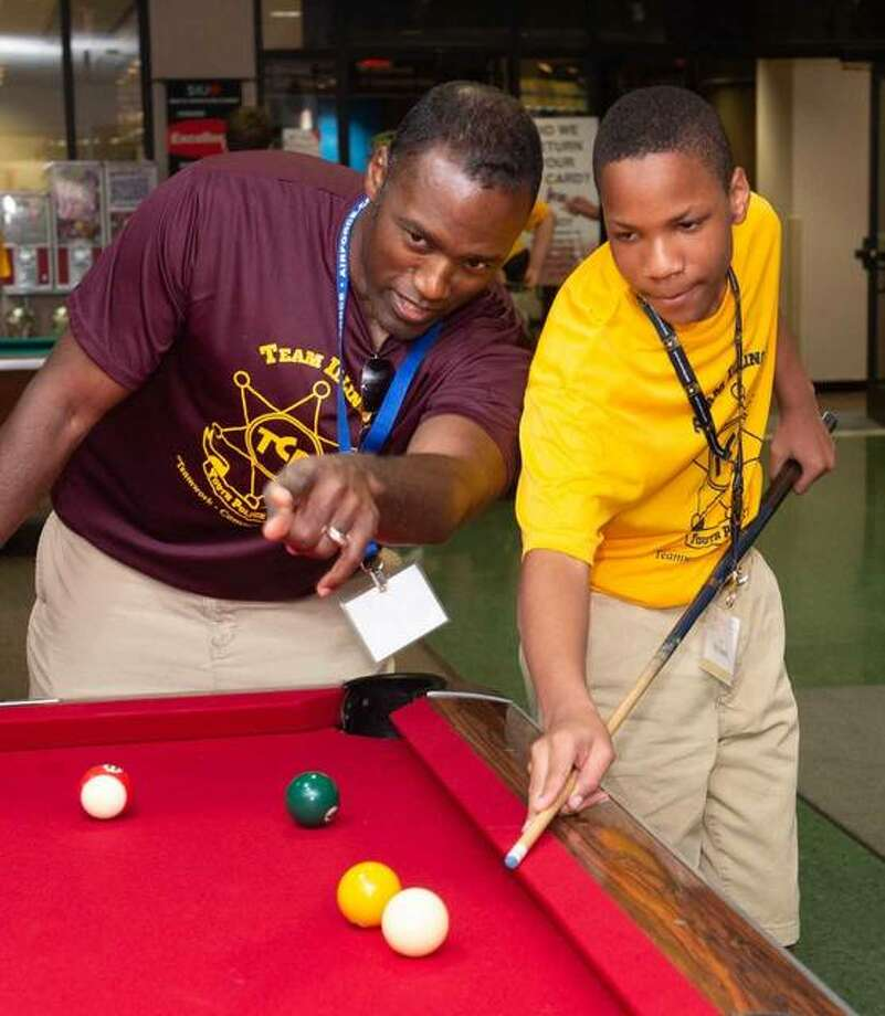 ISP Master Sergeant Elbert Jennings and Milon Dowell, of Collinsville, play pool at Cougar Lanes on the SIUE campus. Photo: Courtesy Of SIUE