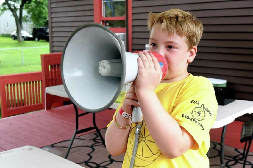 Brendan Mulvaney, 8, uses a megaphone to attract customers to his lemonade stand on Thursday, July 25, 2019 in Ballston Spa, N.Y. Brendan's Lemonade stand will be open outside of Saratoga County fairgrounds until Sunday. (Catherine Rafferty/Times Union)