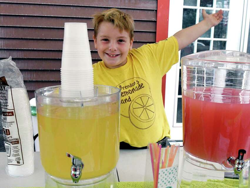 Brendan Mulvaney, 8, poses for a portrait in front of his lemonade stand on Thursday, July 25, 2019 in Ballston Spa, N.Y. Brendan's Lemonade stand will be open outside of Saratoga County fairgrounds until Sunday. (Catherine Rafferty/Times Union)
