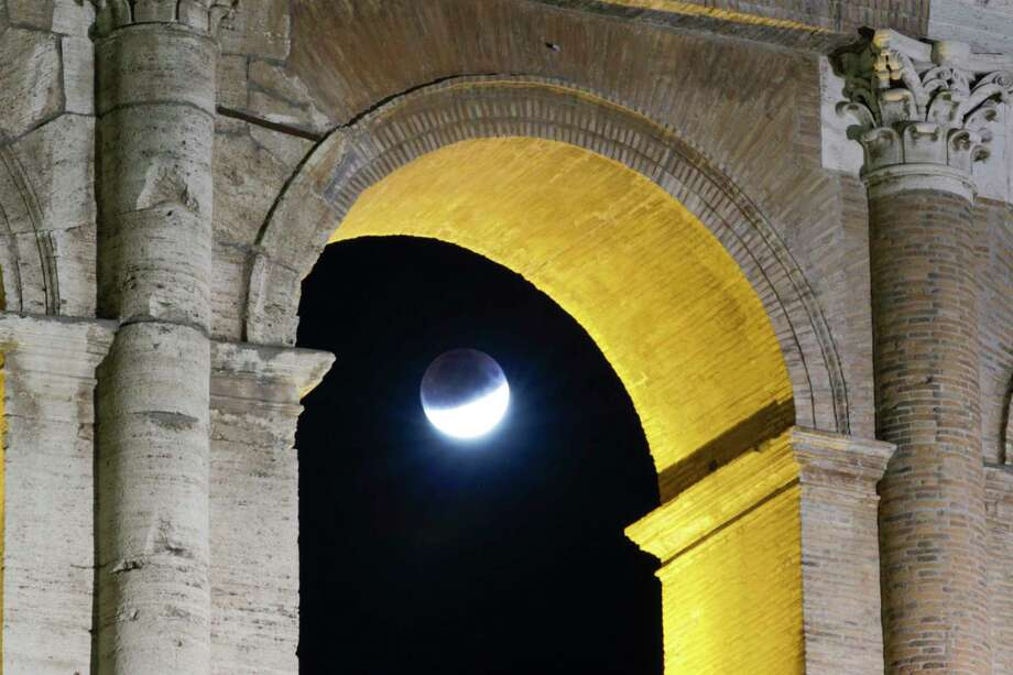 A rising full moon is seen over the Colosseum during a partial lunar eclipse, in Rome, late Tuesday, July 16. The eclipse coincides with the 50th anniversary of the launch on July 16, 1969 of the Apollo 11 mission that landed the first men on the moon. Photo: Andrew Medichini / Associated Press / Copyright 2019 The Associated Press. All rights reserved