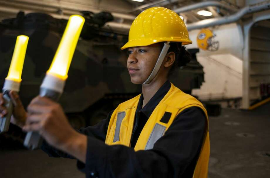 STANAGE BAY, Australia — Seaman Apprentice Christine Bender, from Houston, signals to Landing Craft, Utility 1666 as it departs the well deck of the amphibious transport dock ship USS Green Bay on July 19. Green Bay, part of the Wasp Expeditionary Strike Group, with embarked 31st Marine Expeditionary Unit, is currently participating in Talisman Sabre 2019 off the coast of Northern Australia. A bilateral, biennial event, Talisman Sabre is designed to improve U.S. and Australian combat training, readiness and interoperability through realistic, relevant training necessary to maintain regional security, peace and stability. Photo: Mass Communication Specialist 2nd Class Anaid Banuelos Rodriguez / U.S. Navy Photo