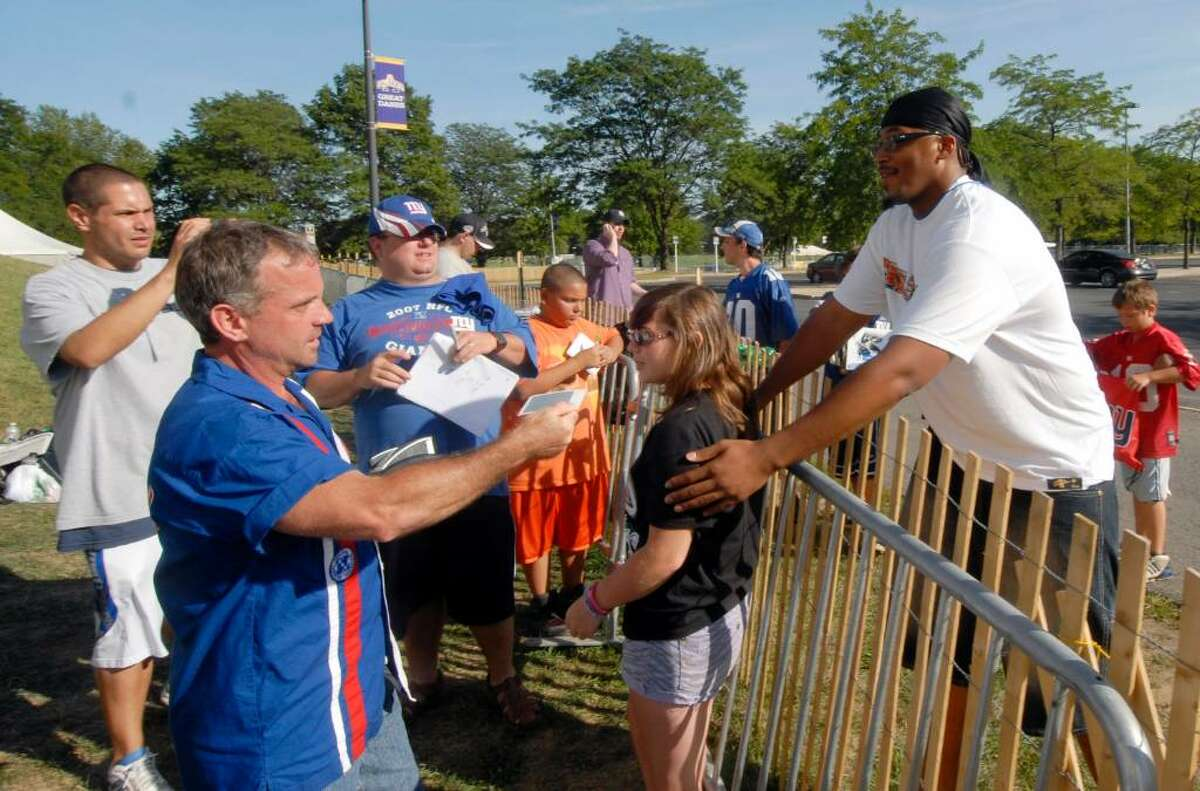 The Giants' William Beatty, right, poses for a photograph with a fan at training camp in Albany. (AP Photo/Hans Pennink)