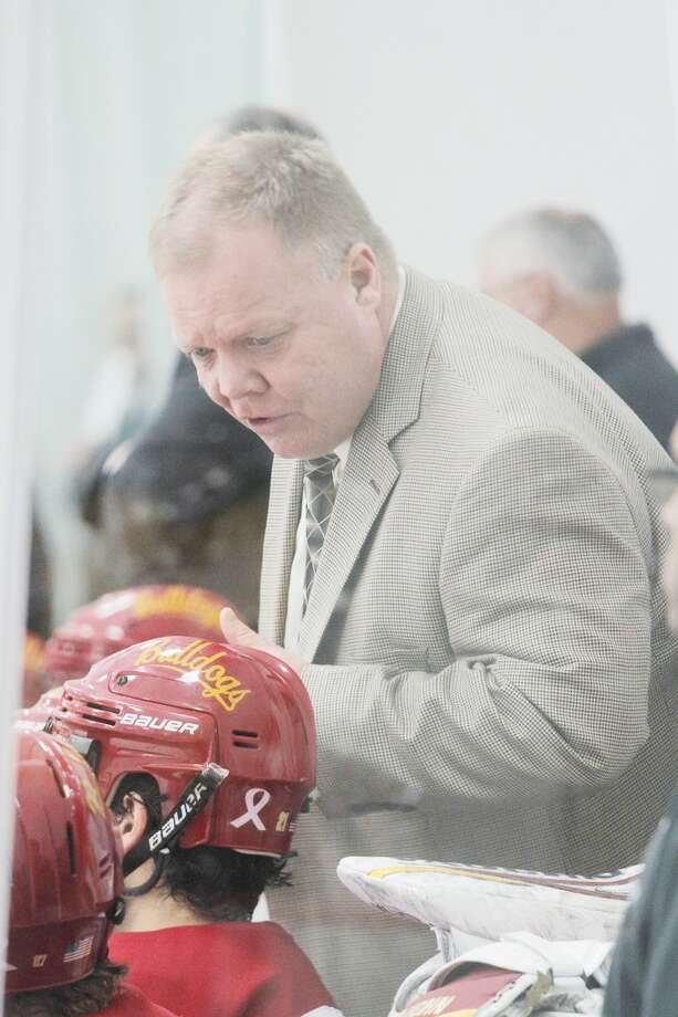 HONORED: Ferris State University hockey coach Bob Daniels guides his players through a game against Ohio State University this weekend. Daniels received a Northern Lights award after Saturday's game. (Pioneer photo/Marty Slagter)