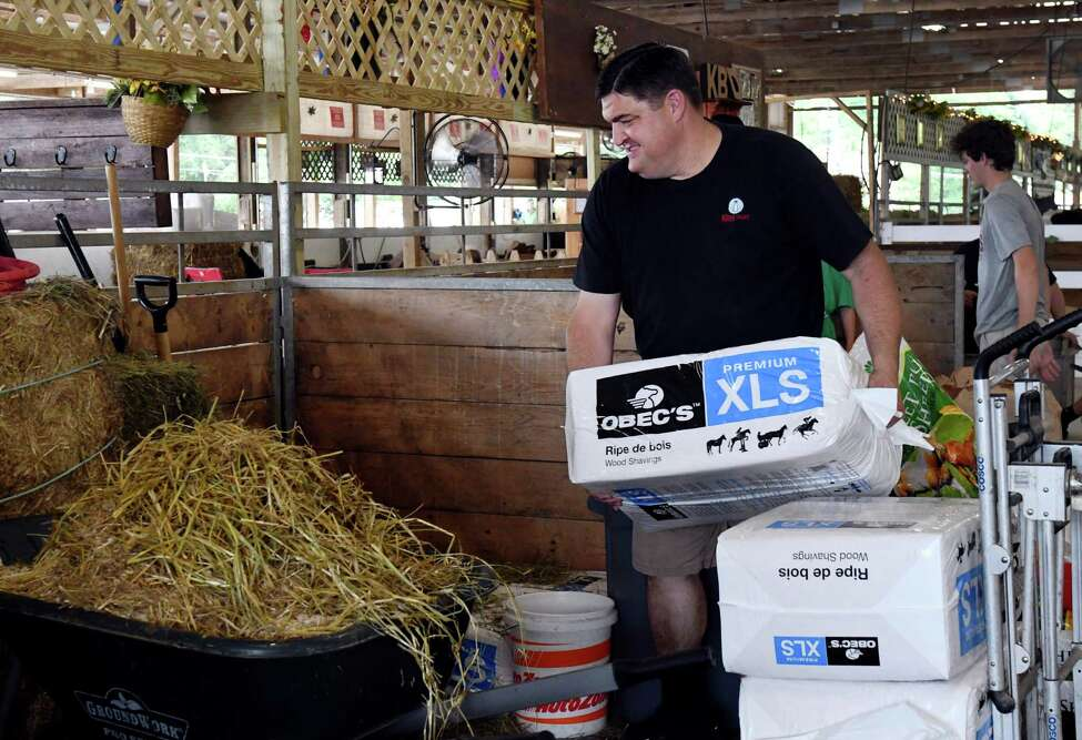 Jeff King of Kings Brothers Dairy unloads hay for his dairy cows in the dairy barn at the Saratoga County Fair on July 25, 2019, in Ballston Spa, N.Y. (Catherine Rafferty/Times Union)