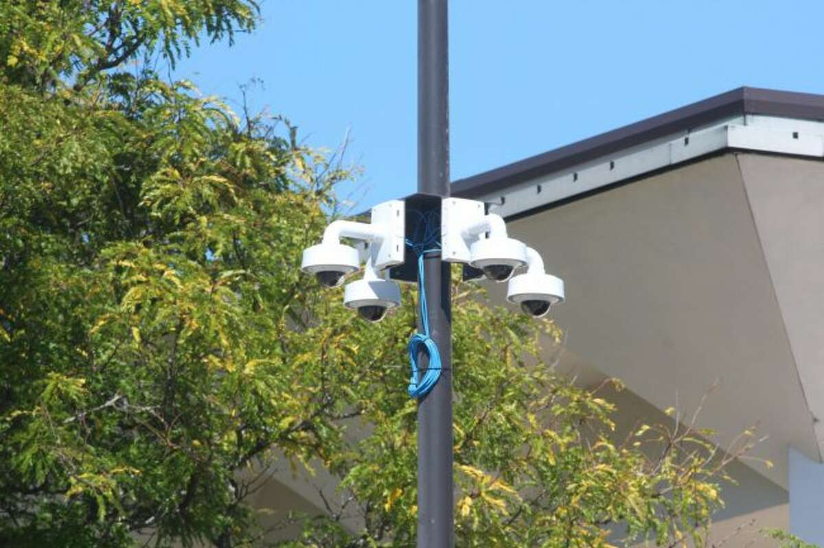 New cameras were installed Wednesday near Pocket Park in downtown Big Rapids. The city currently is installing 30 cameras to add to the 130 in place, which are used by law enforcement and others. (Pioneer photo/Brandon Fountain)