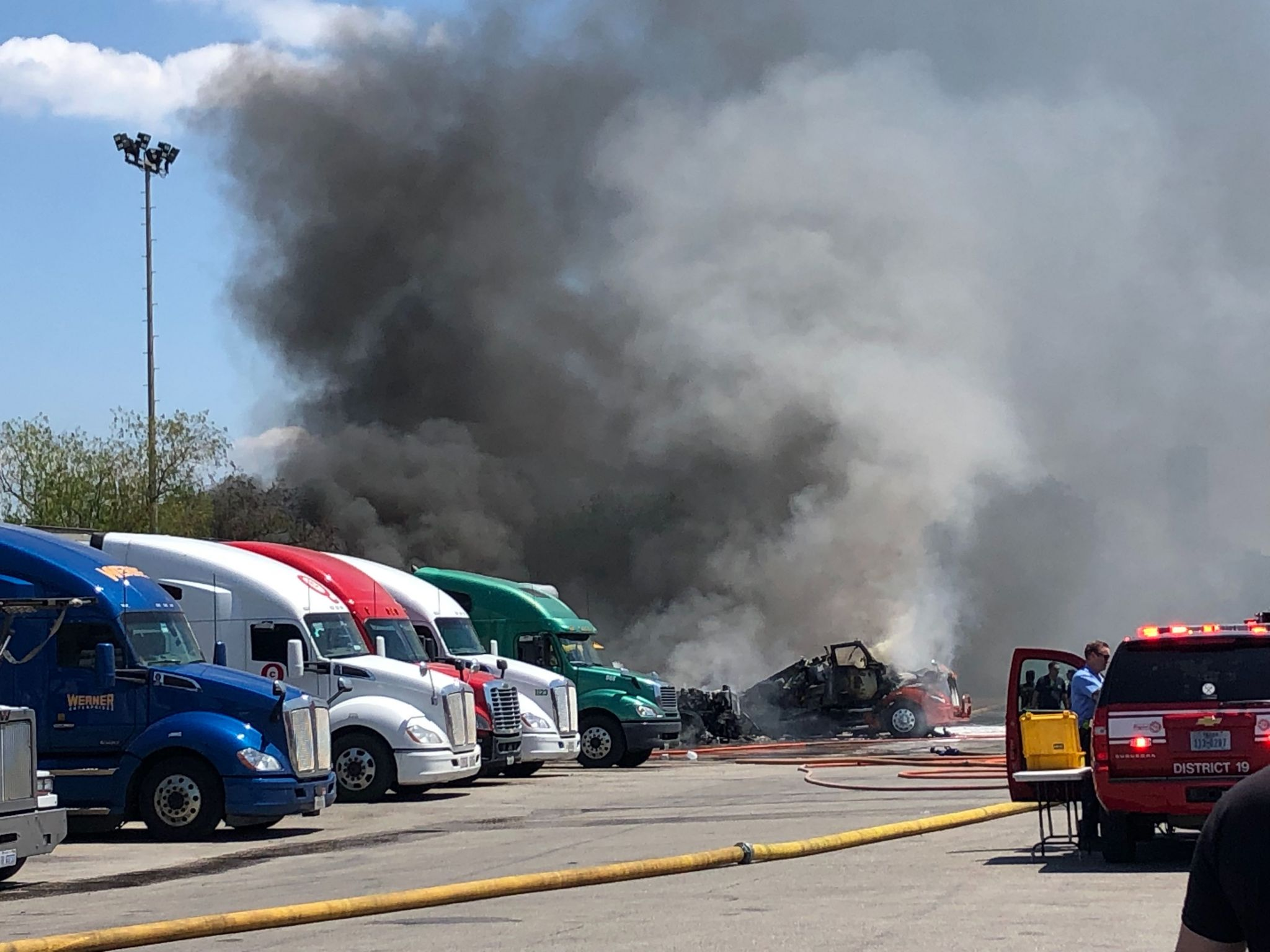 Several 18-wheelers on fire at North Freeway truck stop