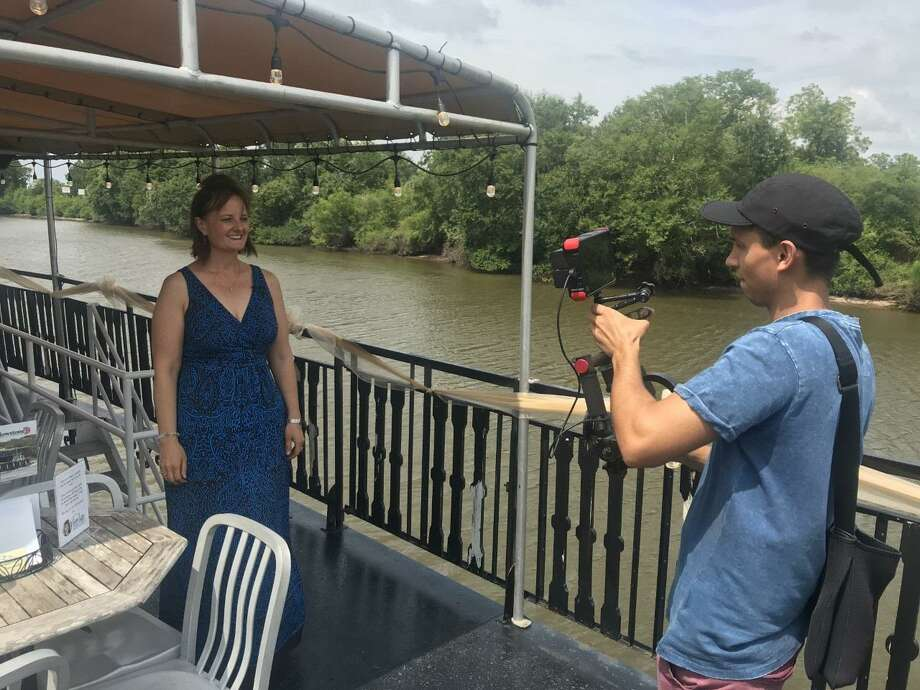 Fort Bend Realtor Sara Nguyen tapes a segment for The American Dream-Houston while on a historic Texas paddleboat on the San Bernard River. Photo: Courtesy Photo