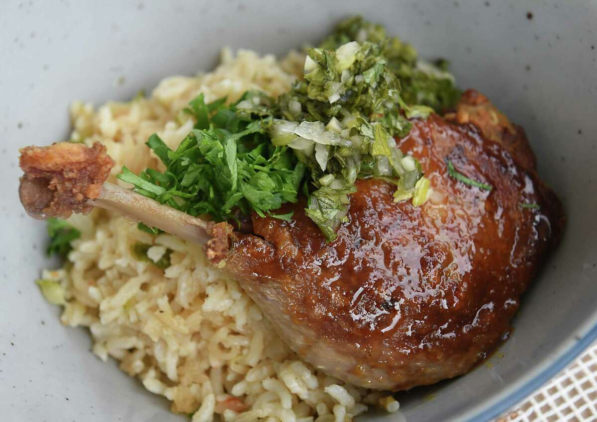 Confit duck, Peruvian northern cilantro, rice, smoked bok choy at Lansing Farm on Thursday, July 18, 2019 in Colonie, N.Y. Field Notes is a seasonal, three-day-a-week restaurant operating at the farm. (Lori Van Buren/Times Union)