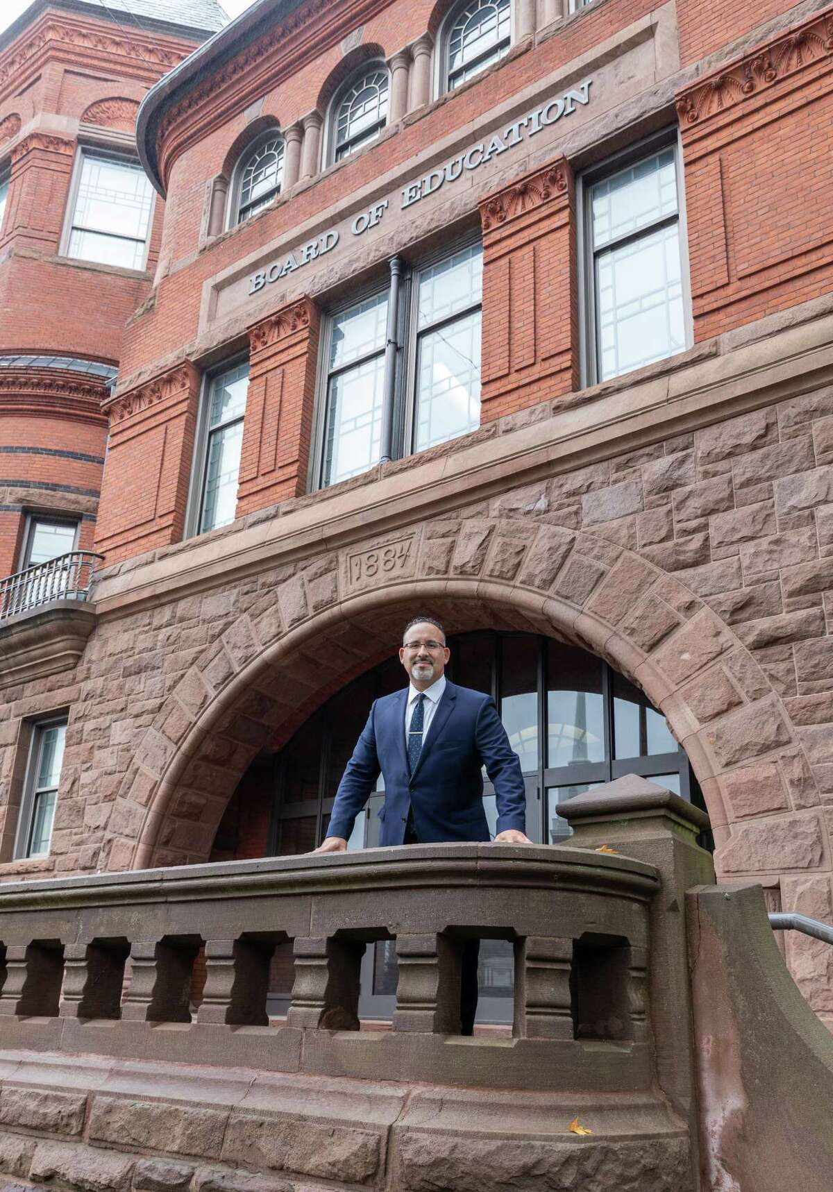 Dr. Miguel Cardona in front of the building in Meriden where for the past four years he has been the assistant superintendent of schools for teaching and learning.