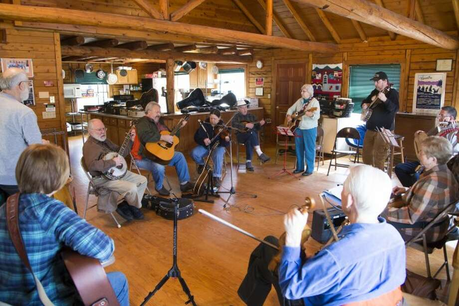 JAM ON: Local musicians and those from other areas of the state gather at the Wheatland Music Organization cabin on Saturday for an acoustic jamboree session. The jamboree event takes place every second weekend of each month, except September. (Pioneer photos/Karin Armbruster)