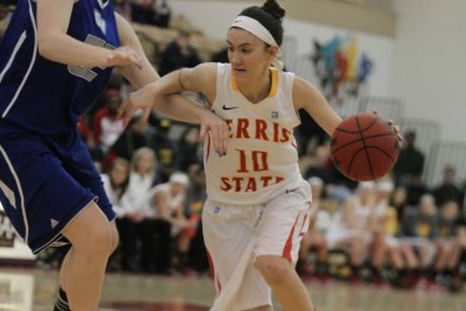 DRIVING: Ferris State's Kylie Muntz takes the ball to the basket during the first half against Grand Valley State. (Pioneer photo/Martin Slagter)