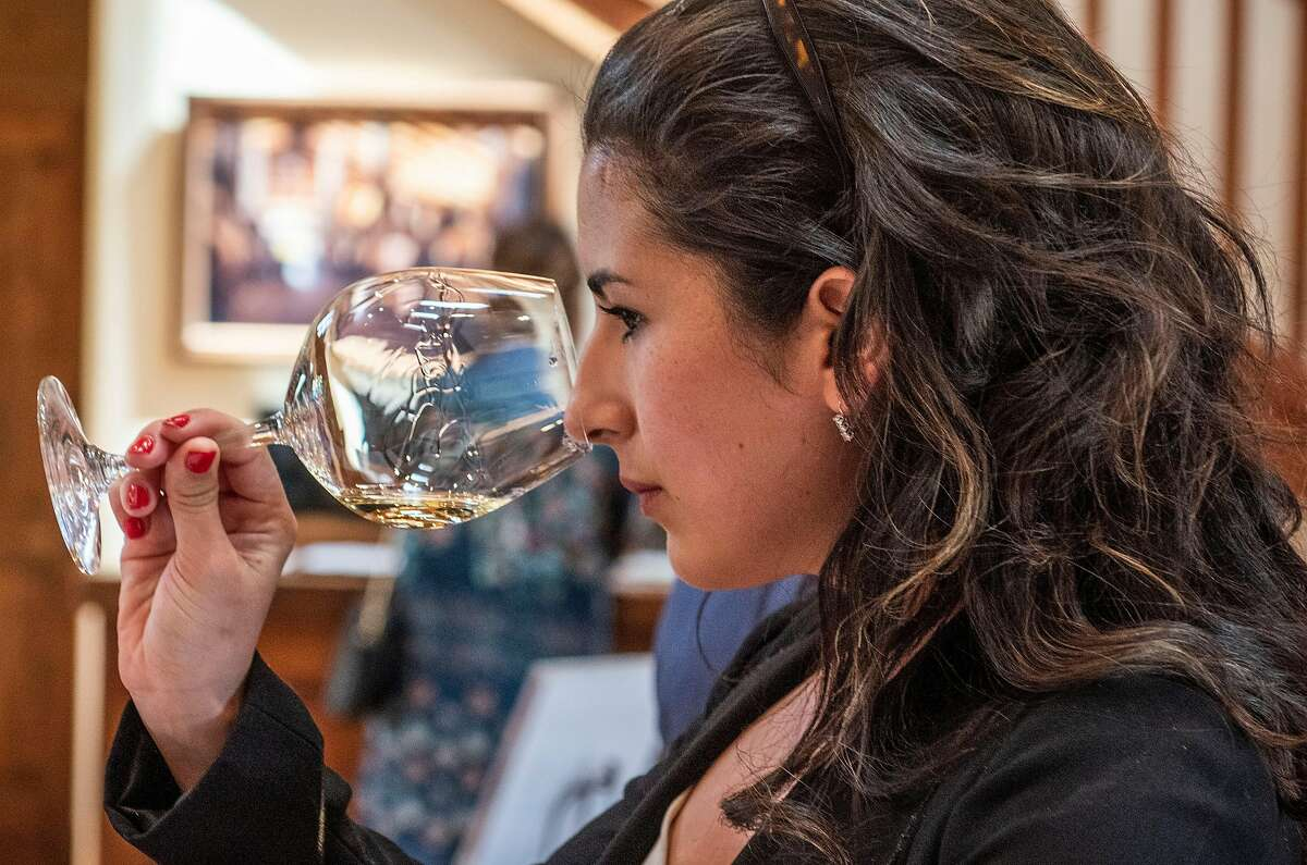 Alexandria Fitzpatrick, of Los Angeles, sniffs the 2015 Sanford Sauvignon Blanc at Sanford WInery's tasting room on Thursday, April 4, 2019, in Lompoc, Ca.