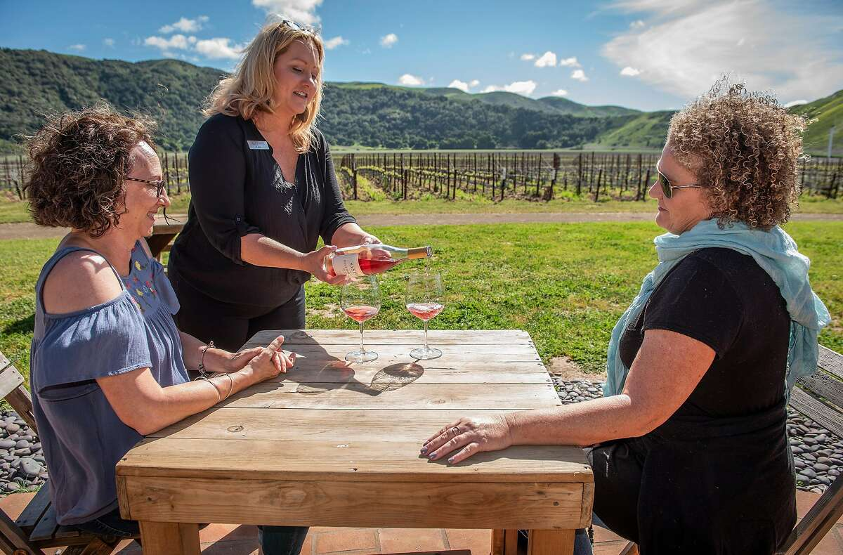 Sommelier Gina Verkamppours a taste of the 2107 Rose of Pinot Noir for tasters Janice Campos, left, and Gina Verkamp at Sanford Winery on Saturday, April 6, 2019, in Lompoc, Ca.