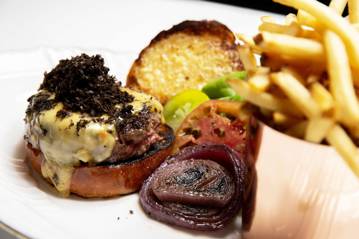 This is what a $50 burger looks like. It's topped with five ounces of truffle.
