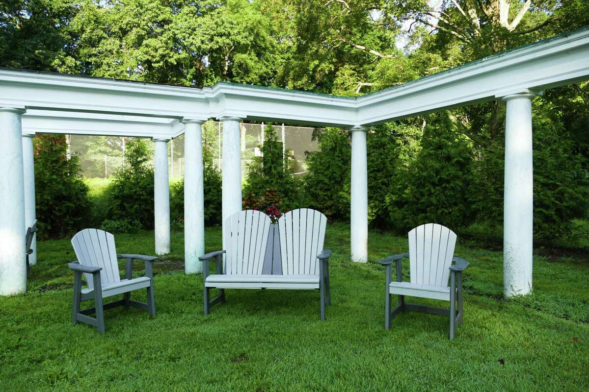The colonnade at Mead Park in New Canaan has new furniture and will be getting a flagstone-like flooring to invite people to socialize after a tennis game.