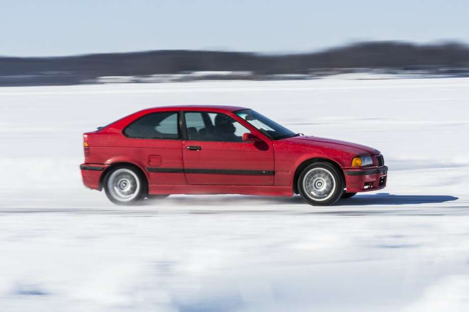 NO TRACTION: Cars on Chippewa Lake this past weekend were like a blur as they passed by the race track check points. The cars are stripped down to make them as light as possible. The less horsepower a car has, the better it will do on the ice. (Pioneer photos/Justin McKee)