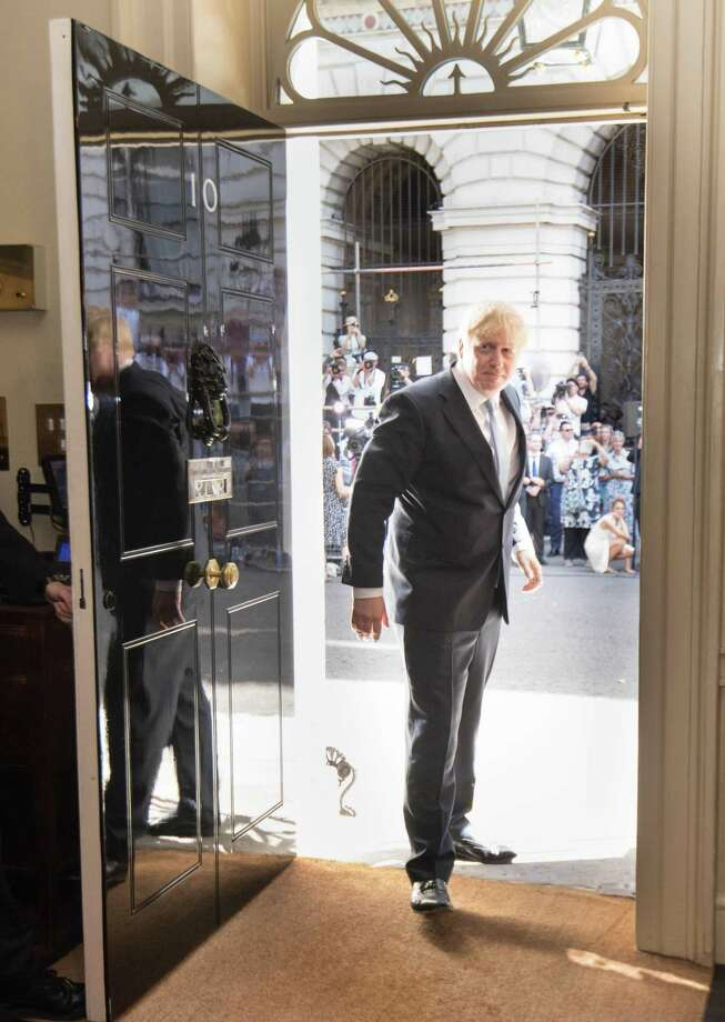 LONDON, ENGLAND - JULY 24: New Prime Minister Boris Johnson arrives in 10 Downing Street on July 24, 2019 in London, England. Boris Johnson, MP for Uxbridge and South Ruislip, was elected leader of the Conservative and Unionist Party yesterday receiving 66 percent of the votes cast by the Party members. He will take the office of Prime Minister this afternoon. (Photo by Stefan Rousseau - WPA Pool/Getty Images) Photo: WPA Pool / Getty Images / 2019 Getty Images