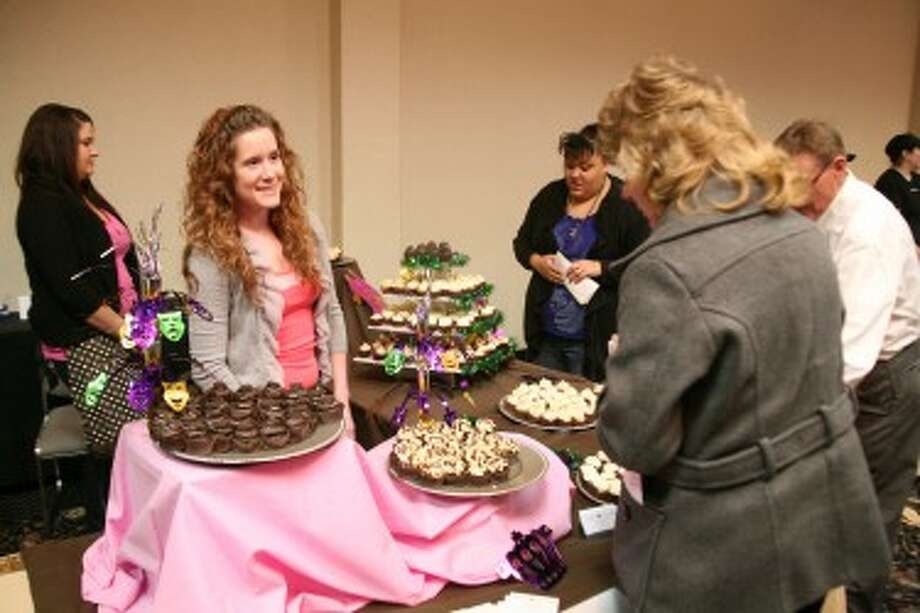 HELLO CUPCAKE: Nyssa Meyer (left), of Hello Cupcake, helps Connie Koepke, director of the Mecosta County Area Convention and Visitors Bureau decide which dessert to eat. (Pioneer photos/Jonathan Eppley)